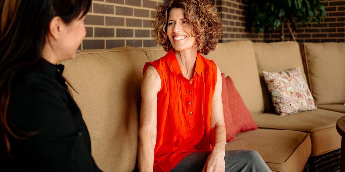 Nancy Stevens on couch