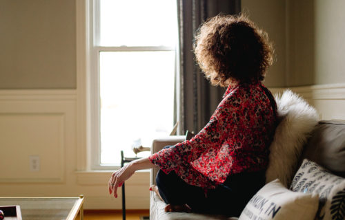 Silence for self care | Life Coach Nancy Stevens | woman sitting on couch near window
